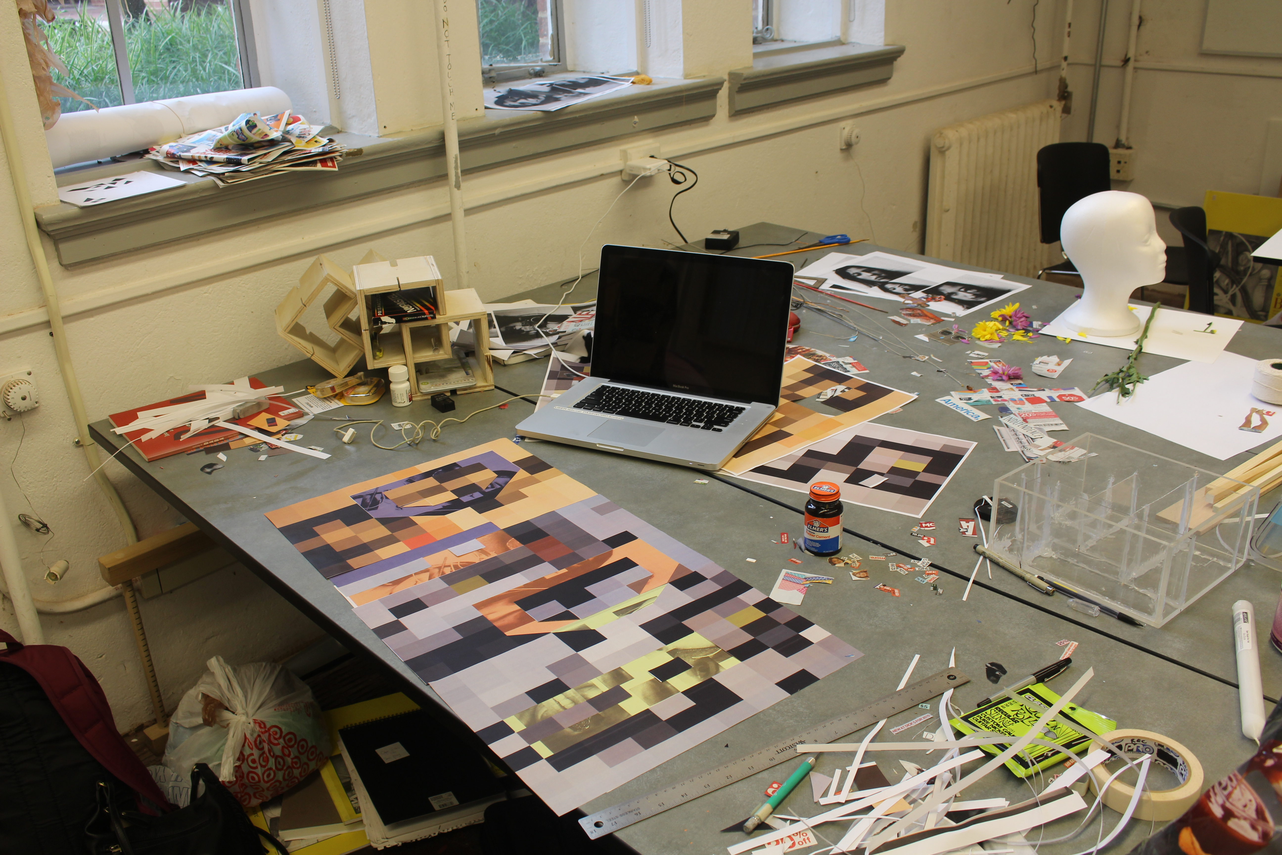 Jeanna's studio desk is covered with art supplies and materials from her projects.